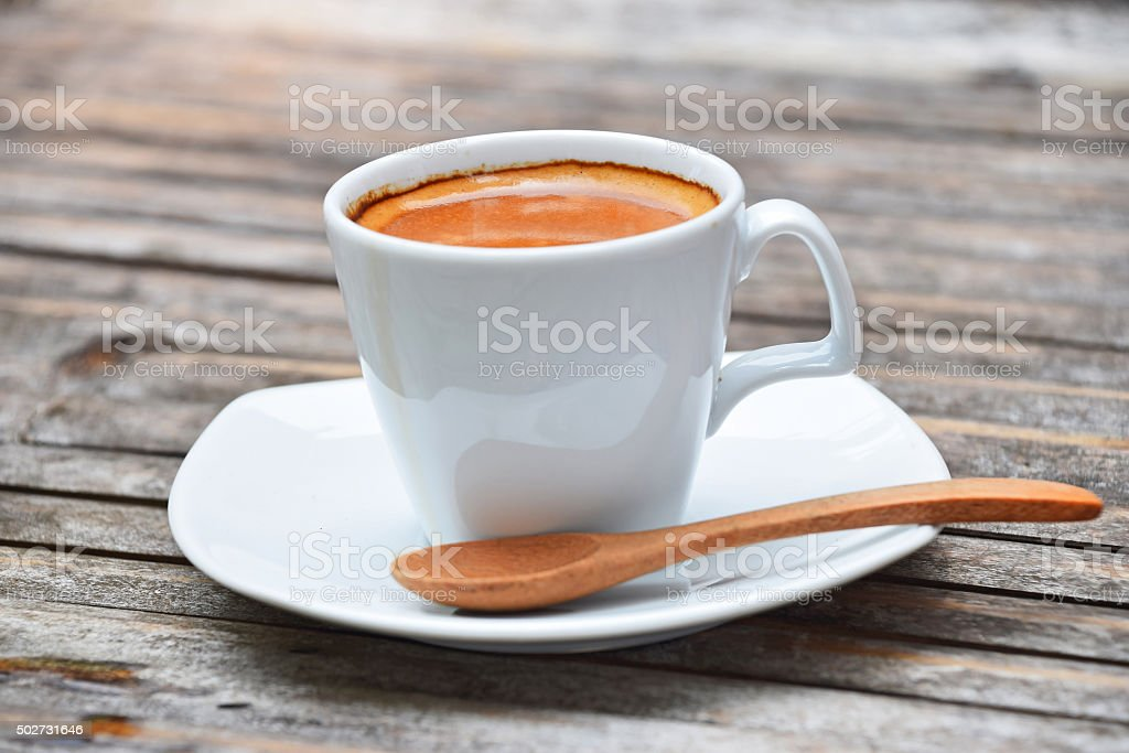 One full cup of espresso coffee on bamboo table royalty-free stock photo