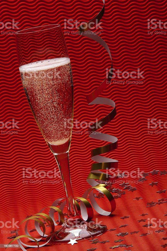 One glass glasses champagne redbackground (XXXL) stock photo