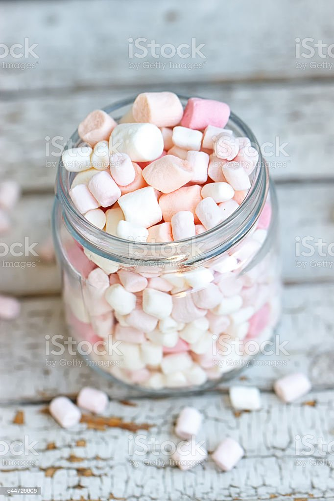 One glass jar filled up with marshmallow stock photo