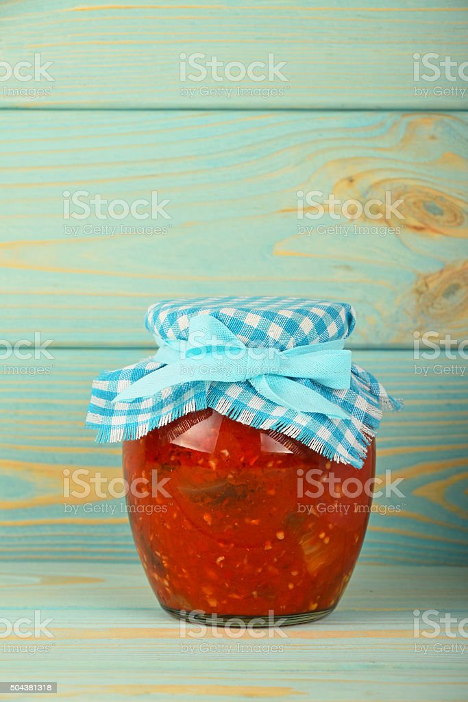 One glass jar of pickled pepper salad at blue wood royalty-free stock photo