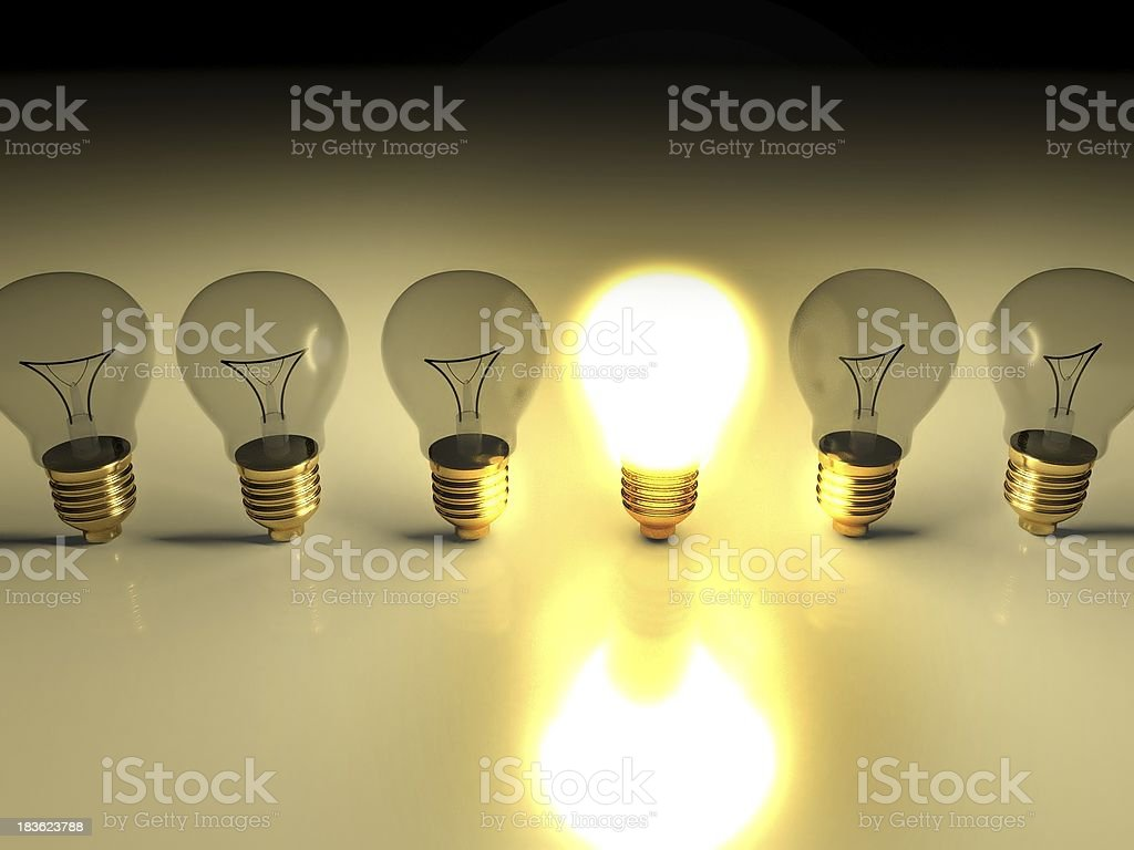 One glowing light bulb amongst other bulbs, concept of idea royalty-free stock photo