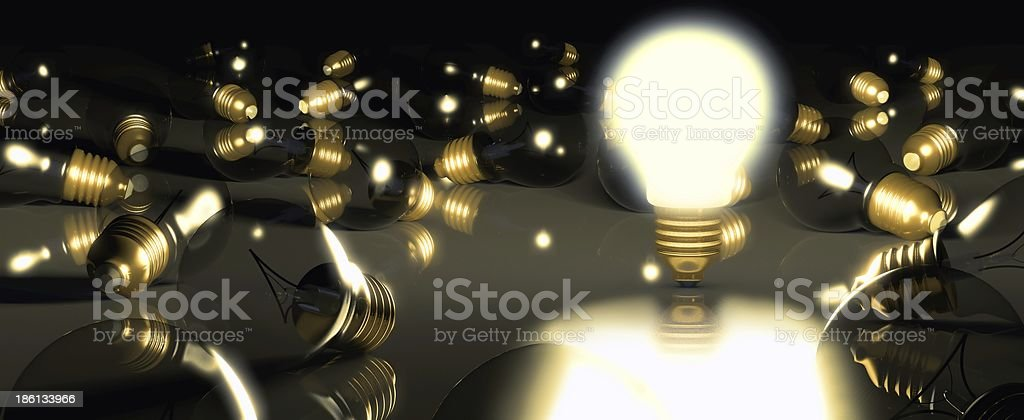 One glowing light bulb amongst other bulbs royalty-free stock photo