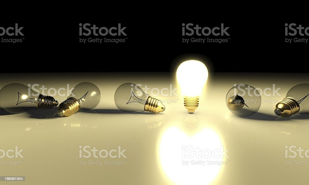 One glowing light bulb and the other bulbs in rows stock photo