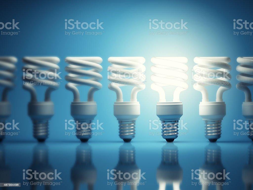 One glowing light bulb stock photo