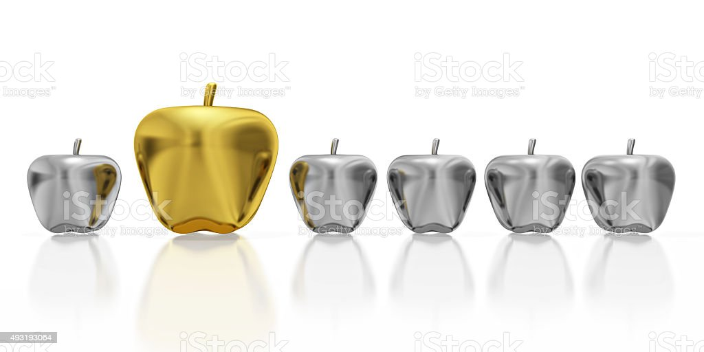 One Golden Apple in Row of Silver Apples stock photo