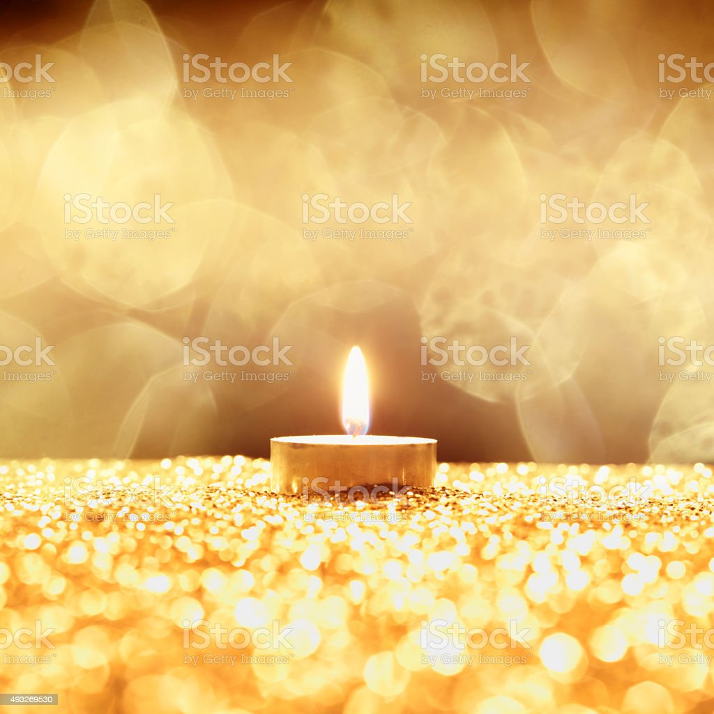 one golden candle stock photo