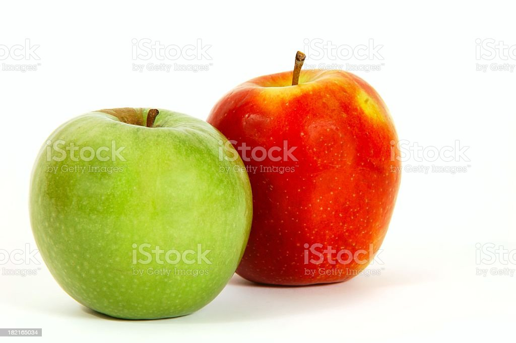 One green and one red apple on a white background stock photo