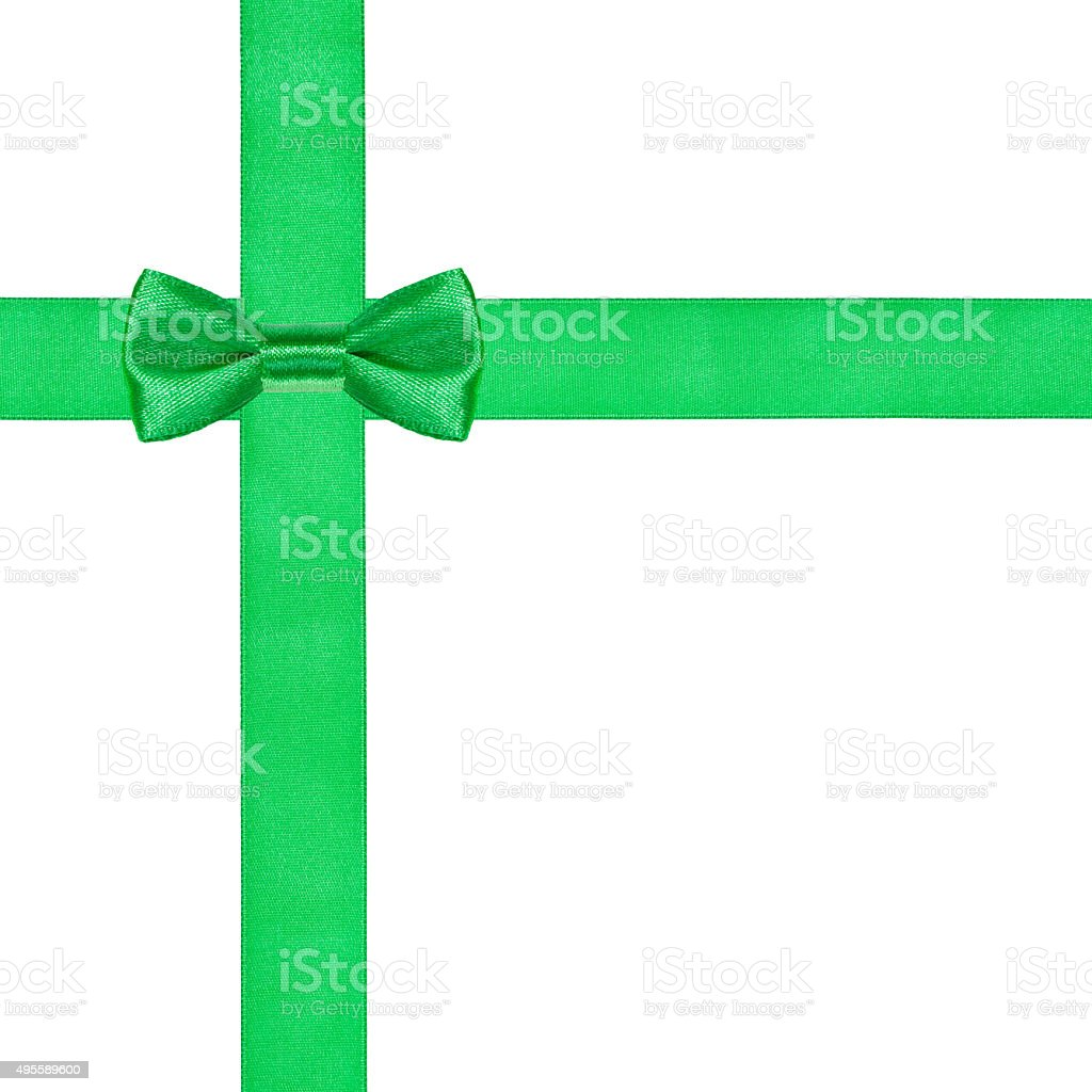 one green bow knot on two crossing satin ribbons stock photo