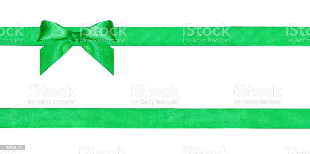 one green bow knot on two parallel silk ribbons stock photo