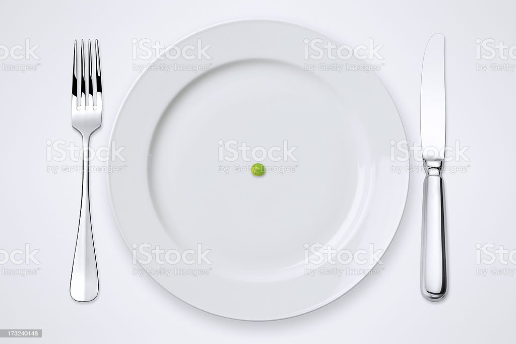 One Green Pea On Plate. Table Setting With Clipping Path. royalty-free stock photo