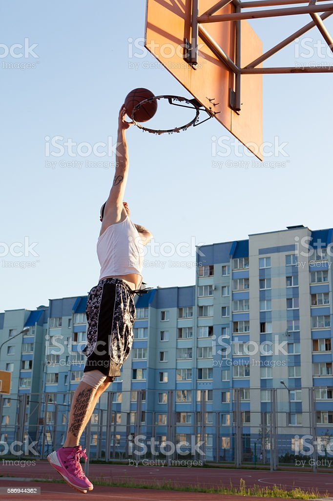 One guy play basketball at district sports ground. stock photo