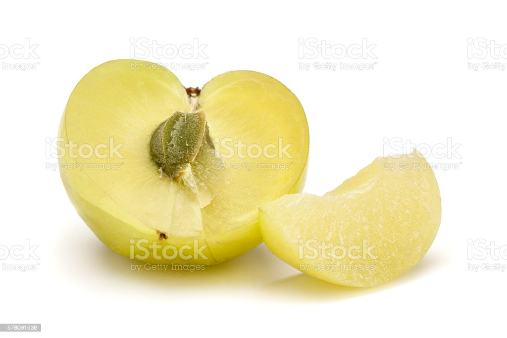 One half and a slice of Organic Indian gooseberry. stock photo