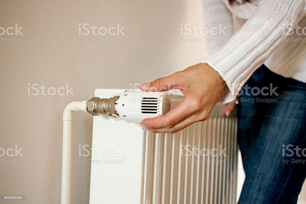 One hand adjust thermostat valve stock photo