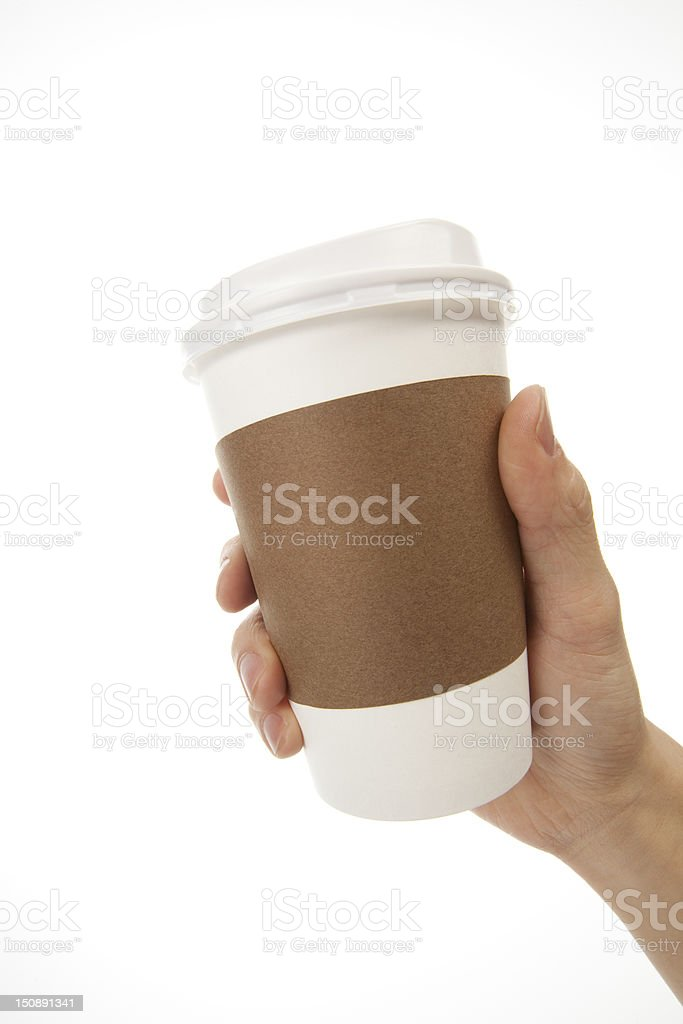 One hand holding white coffee cup with brown cup holder stock photo