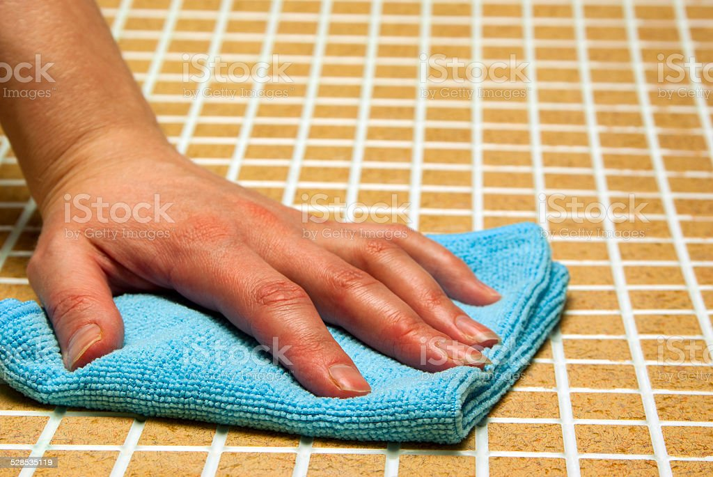 One hand in a blue cloth royalty-free stock photo