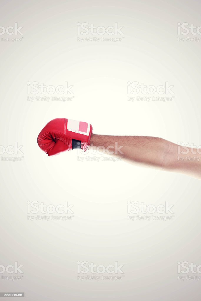 One Hand In The Frame Wearing Red Boxing Gloves stock photo