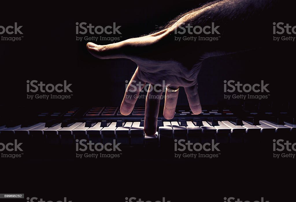 One Hand on a Midi Controller stock photo