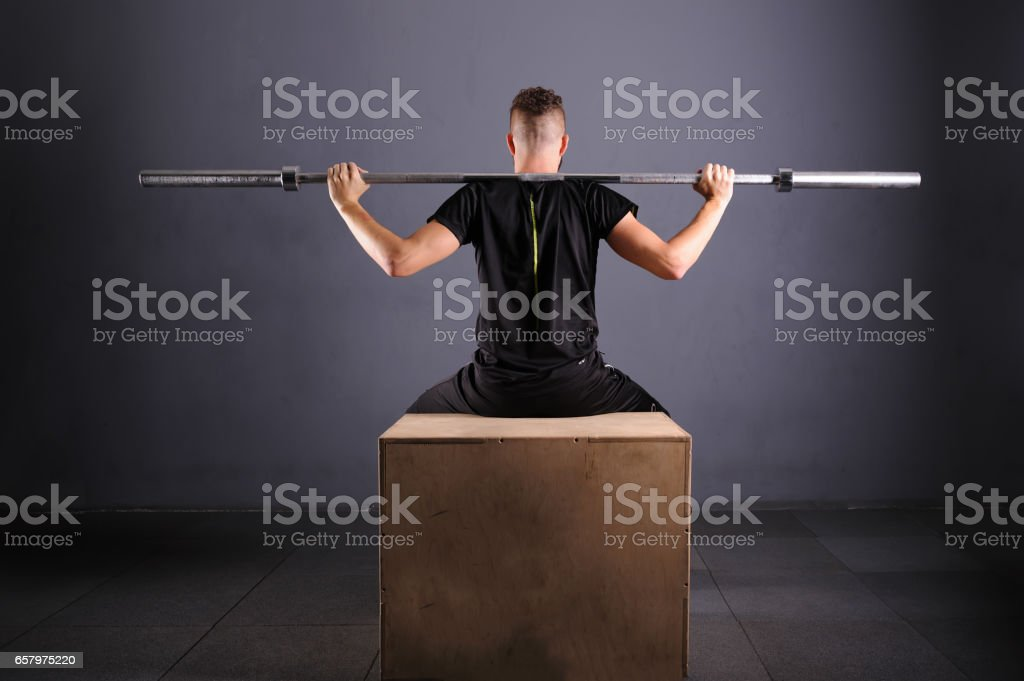 One handsom man topless lifting barbel. Crossfit fitness gym heavy weight bar by strong workout stock photo