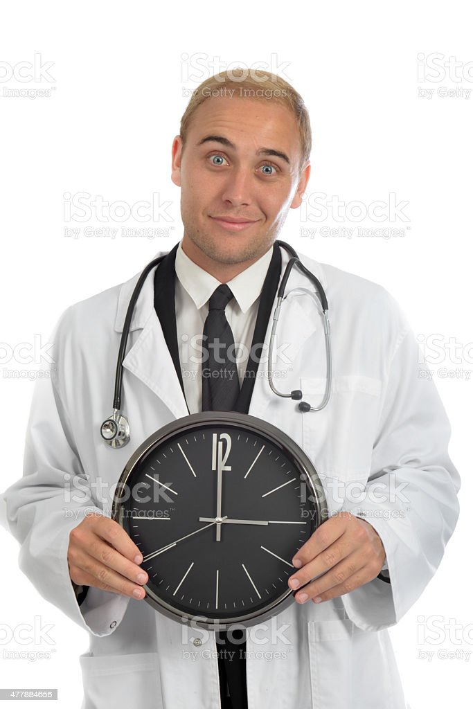 One handsome young male doctor holding a clock stock photo