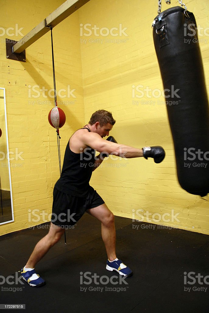 One handsome young man working boxing in a gym royalty-free stock photo