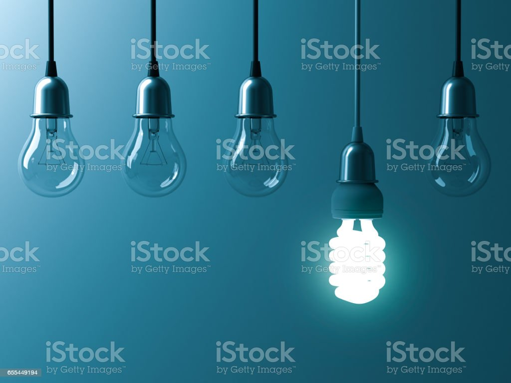 One hanging energy saving light bulb glowing different stand out from unlit incandescent bulbs with reflection on dark cyan background , leadership and different creative idea concept 3D rendering stock photo