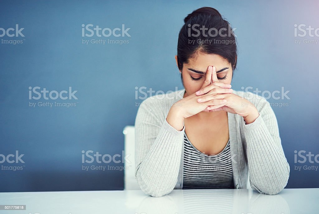 Shot of a businesswoman looking stressed at her...