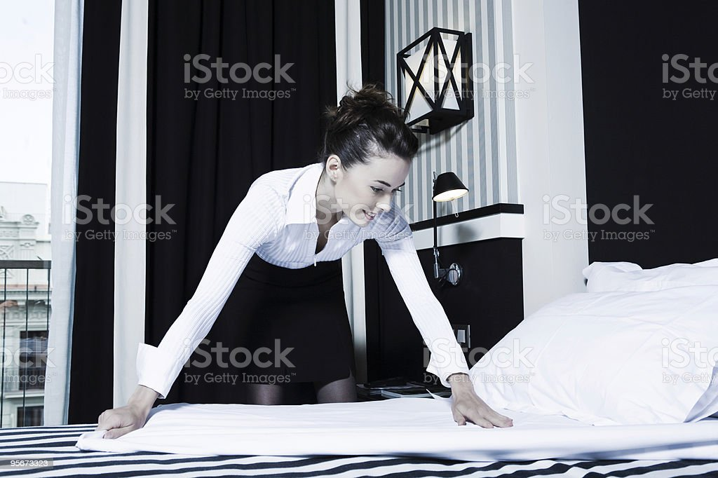 one hotel room housekeeping woman stock photo