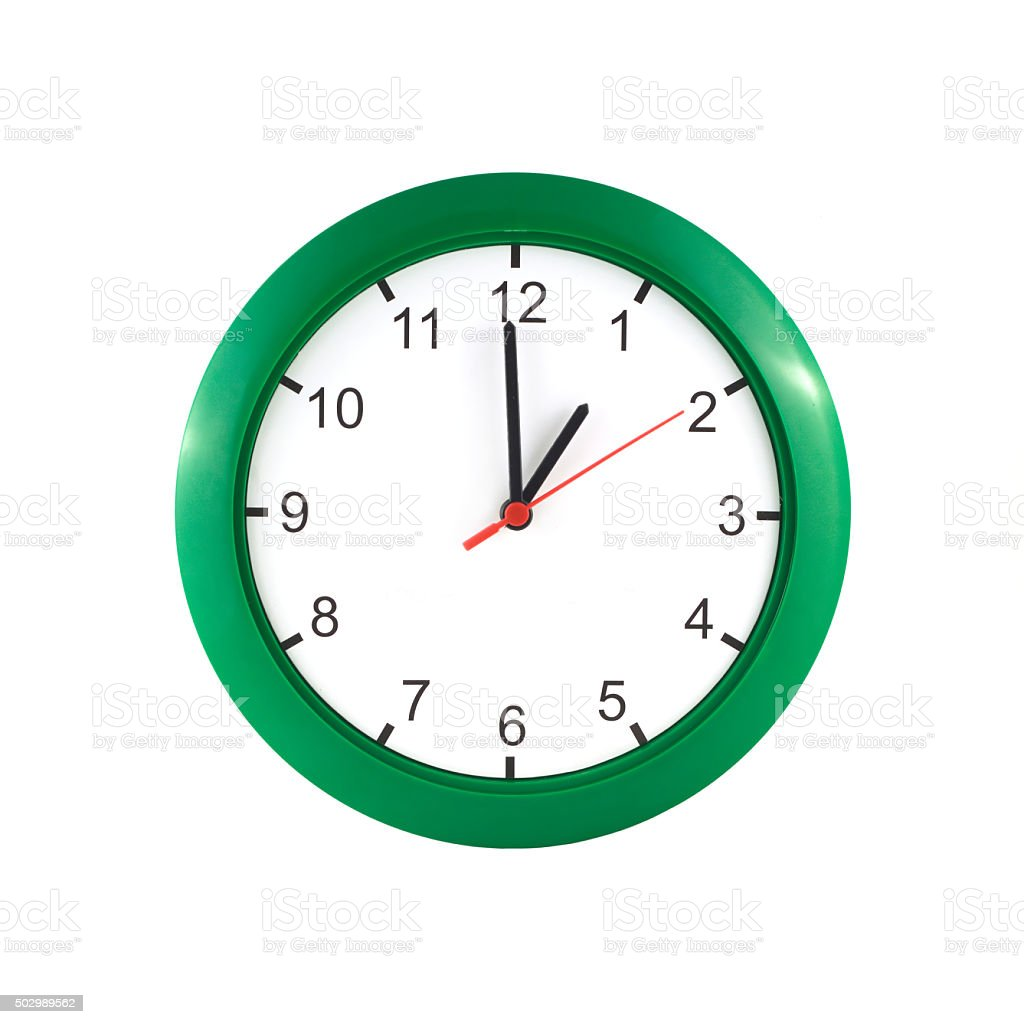 One hour on green wall clock stock photo