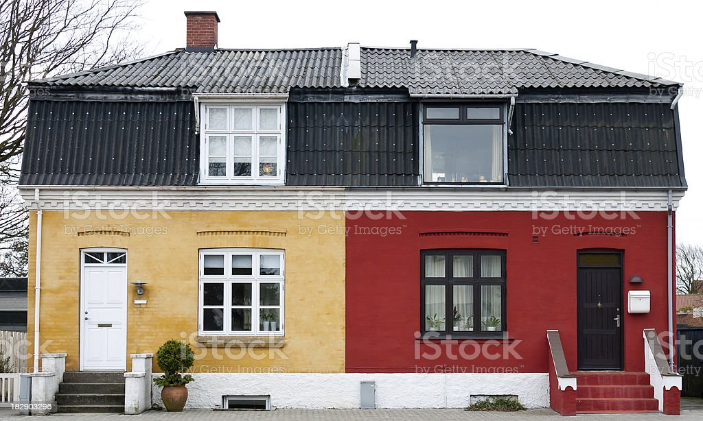 One house painted red on one side and yellow on the other royalty-free stock photo