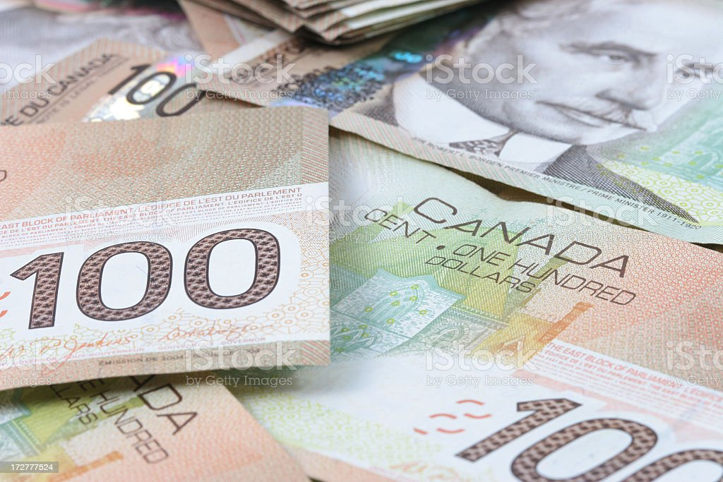 One Hundred Canadian Dollar Bills royalty-free stock photo