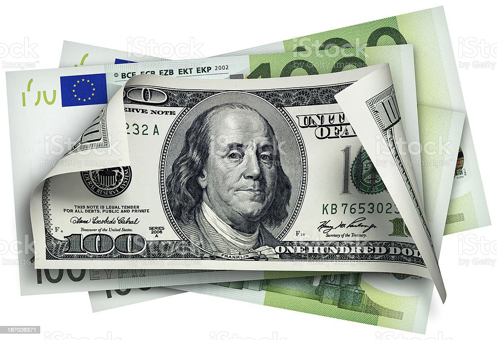 One Hundred Dollar banknotes in front of Euro notes. stock photo