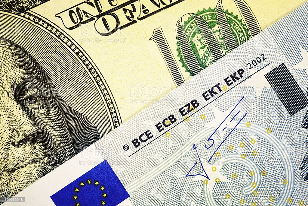 One Hundred Dollar Bill and European Union Euro Note stock photo