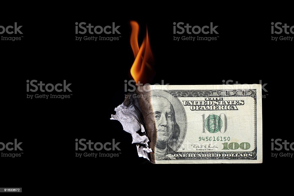 One hundred dollar bill burning stock photo