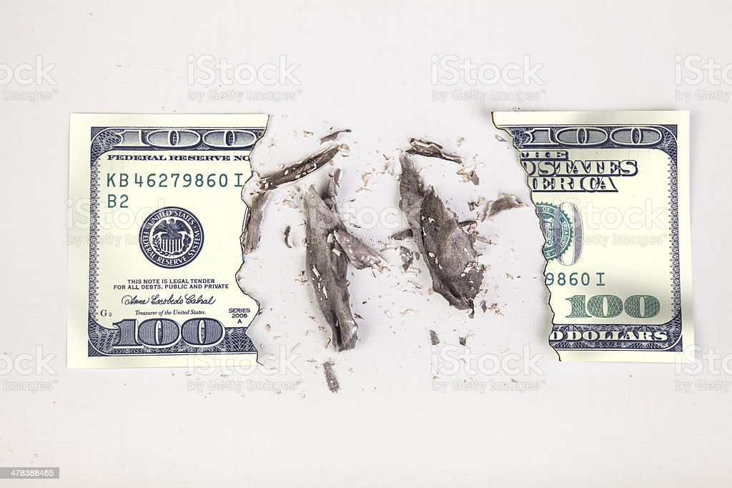 One hundred dollar bill burnt stock photo