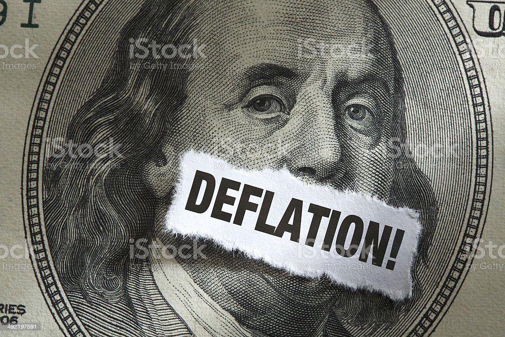 One Hundred Dollar Bill with word Deflation Over it stock photo
