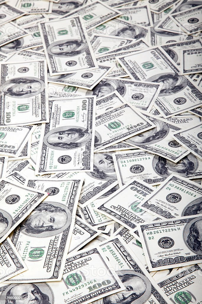 One Hundred Dollar Bills Background - Mess royalty-free stock photo