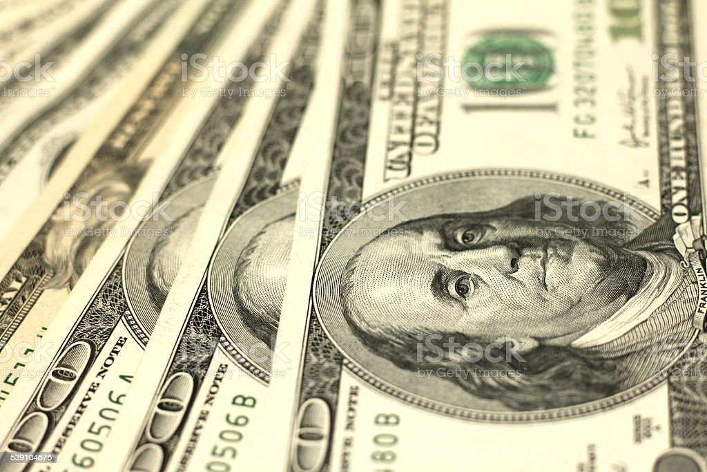 One Hundred Dollar Bills Close-up stock photo