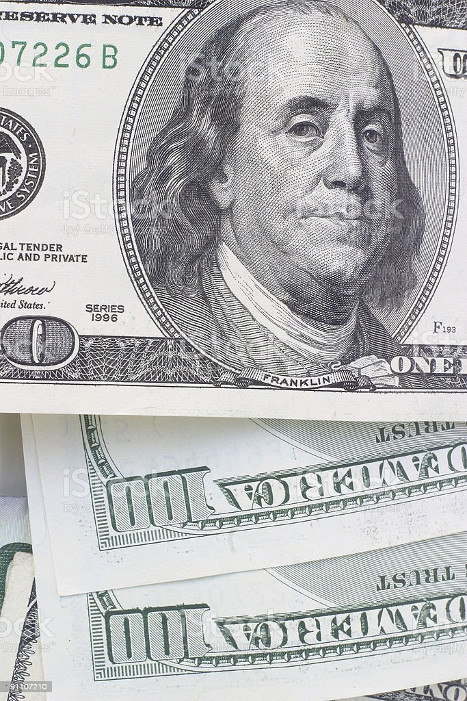 One hundred dollar bills in a pile royalty-free stock photo