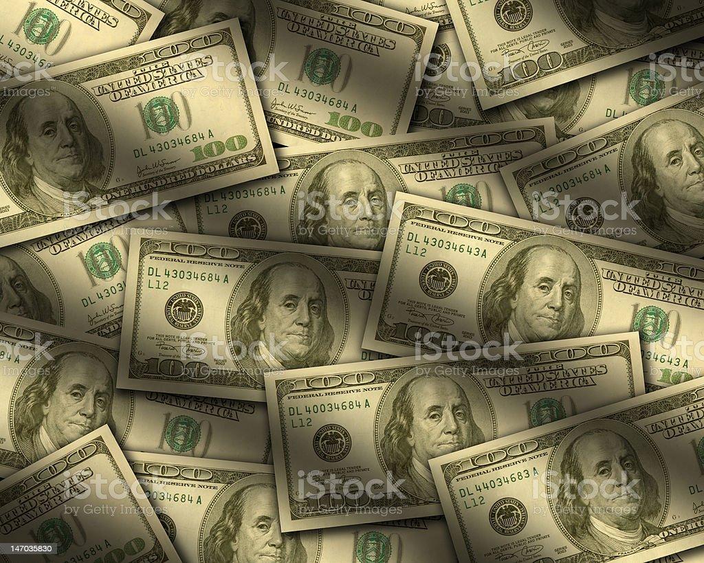 One hundred dollar bills lying flat stock photo