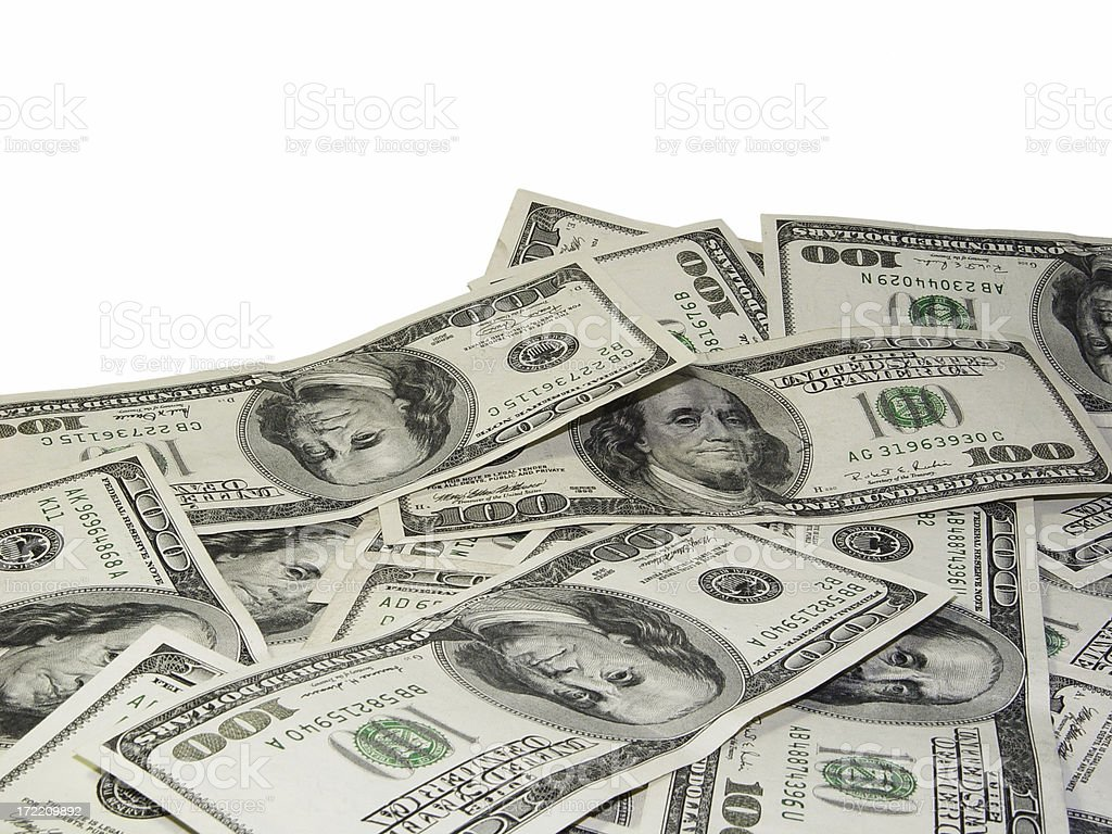 One hundred dollar bills on isolated white background stock photo