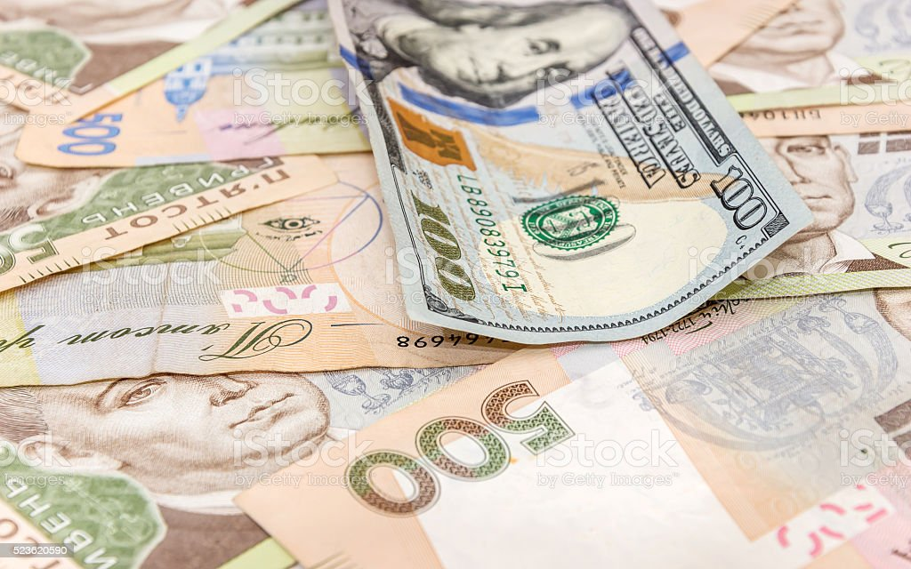 One hundred dollar on the background of the Ukrainian hryvnia stock photo