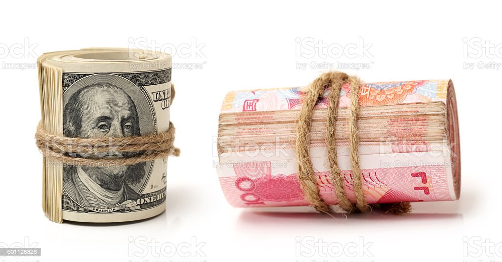 One hundred dollars and china renminbi banknote stock photo