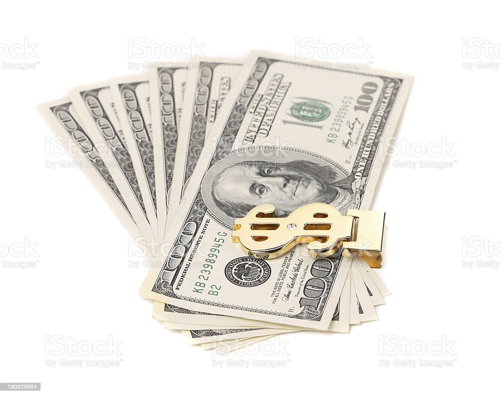 One hundred dollars banknotes in money clip. stock photo