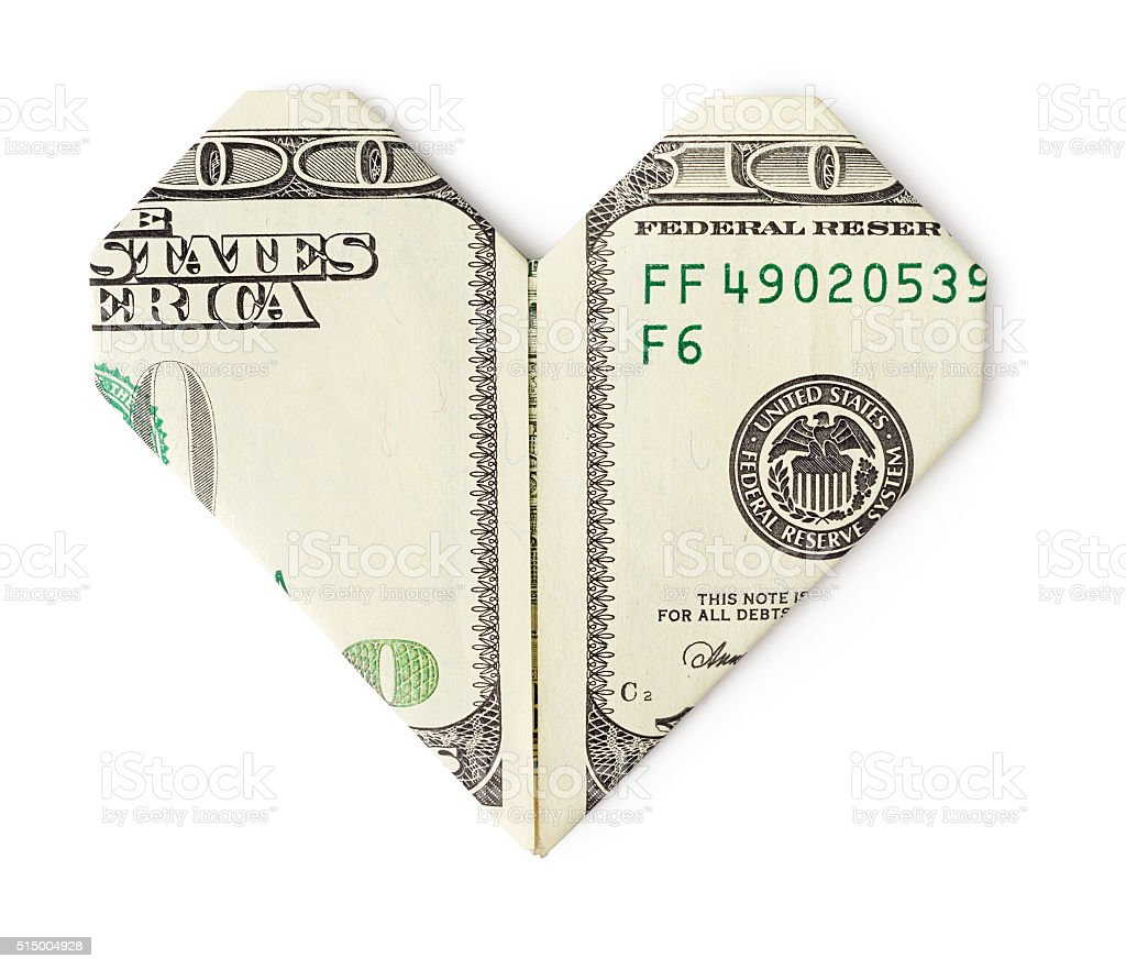 One hundred dollars folded into heart isolated stock photo