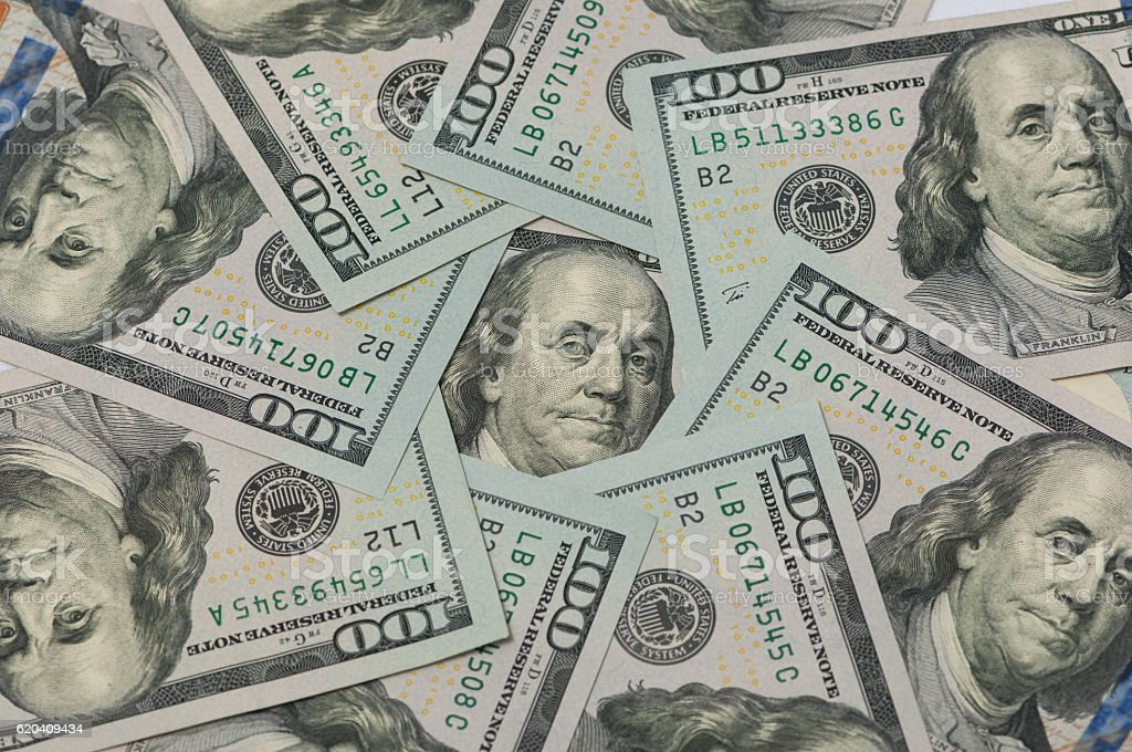 one hundred dollars in a circle stock photo