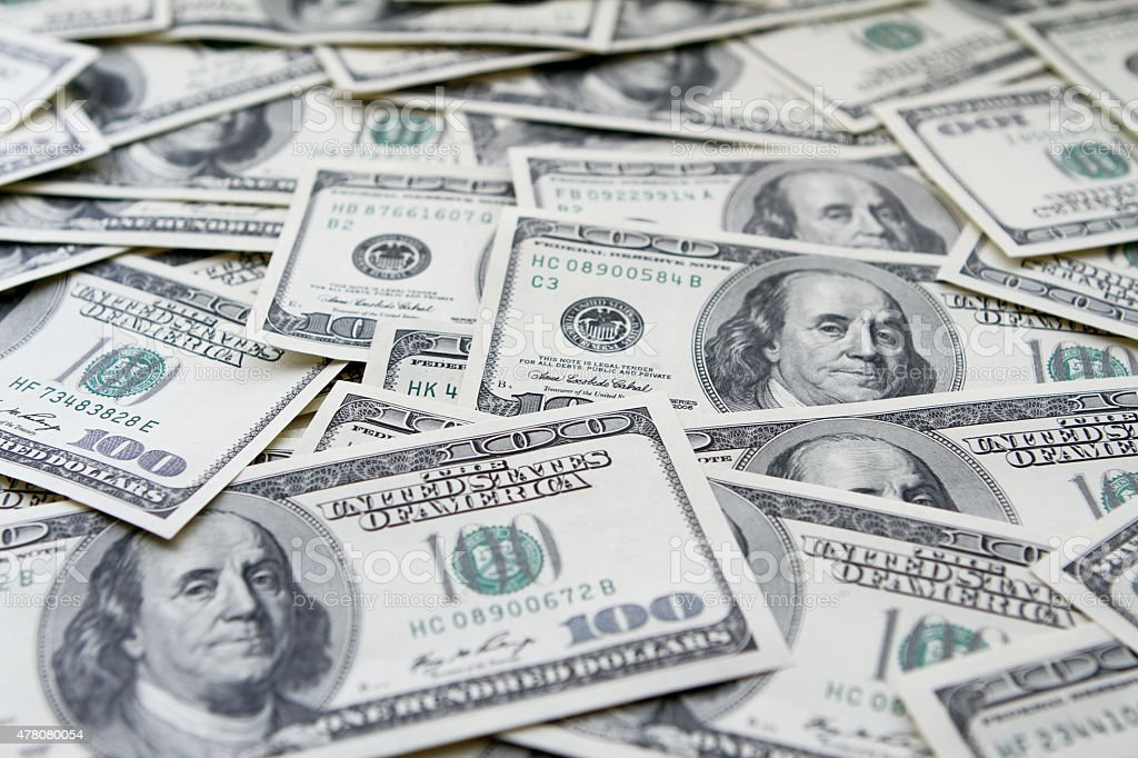 One hundred dollars notes background stock photo