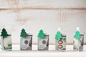 one hundred dollars rolls with clothespins decorated Christmas t