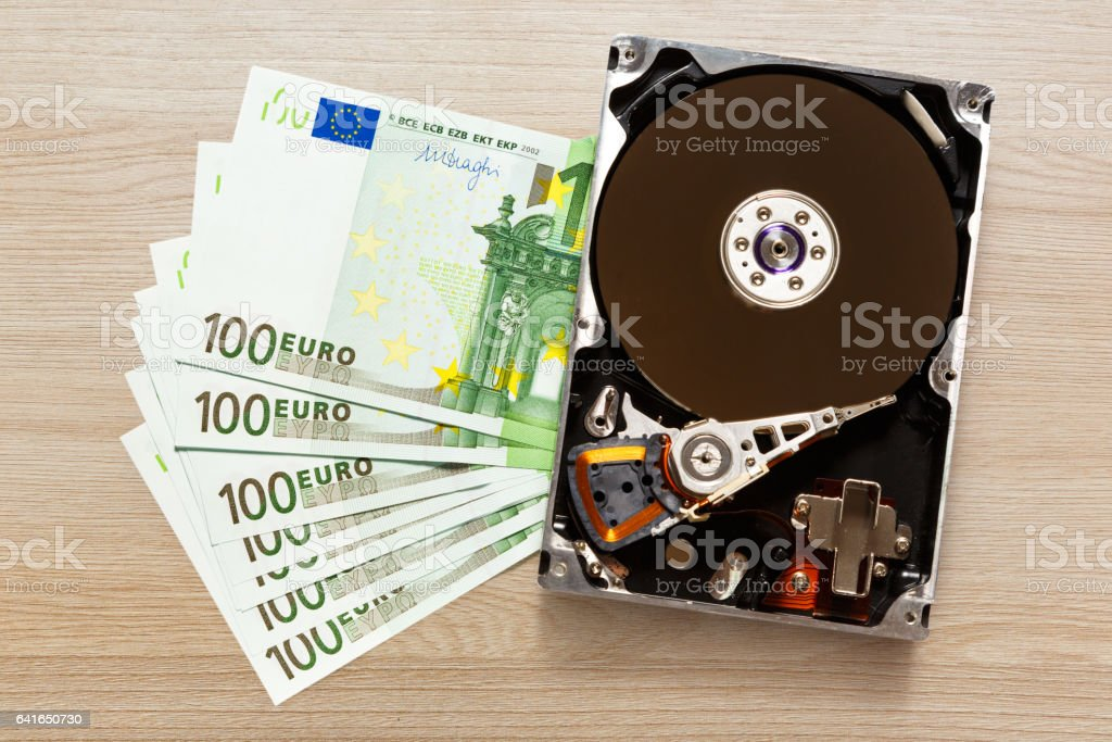 One hundred euro banknotes and hardisk stock photo