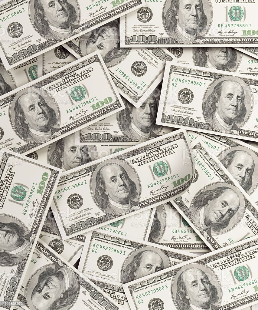 One Hundred US Dollar Bills Background stock photo