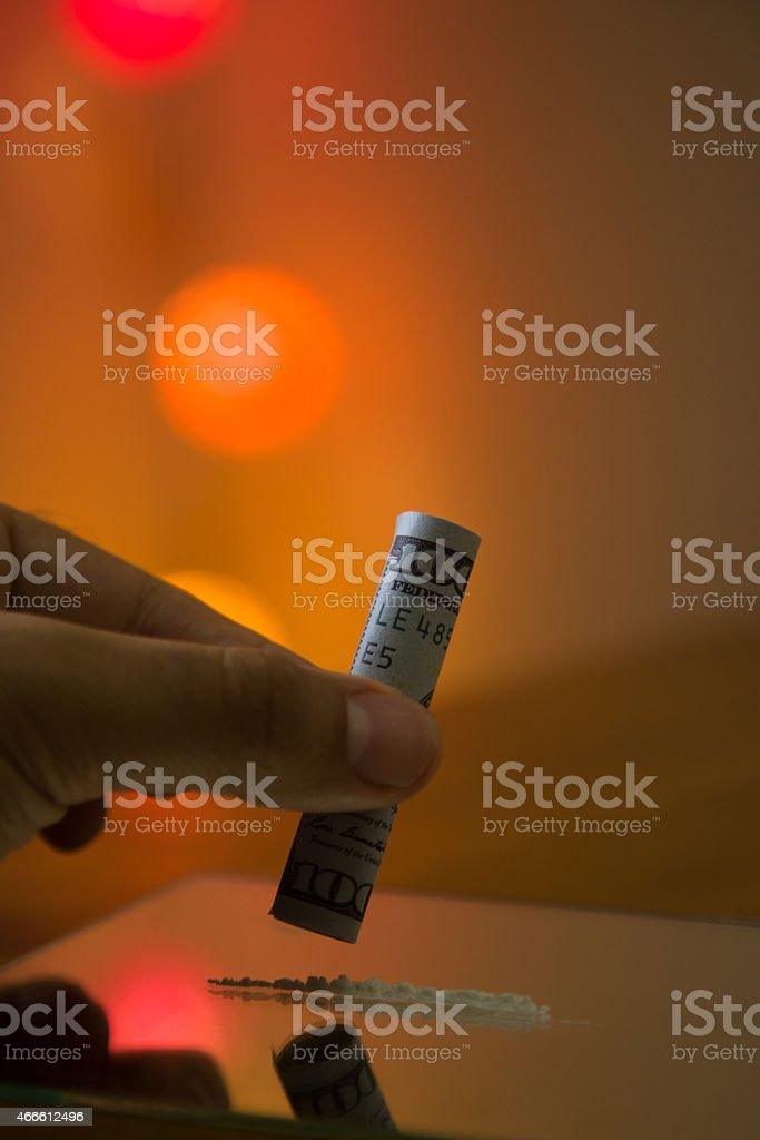one hundred US dollars note to use cocaine . stock photo